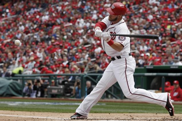 Get used to seeing this swing. Bryce Harper homered on his first two at-bats of 2013. (Photo: Alex Brandon/AP)